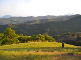 Walking down the mountain after a long day surveying for rare plants in Cascade-Siskiyou National Monument, 2007